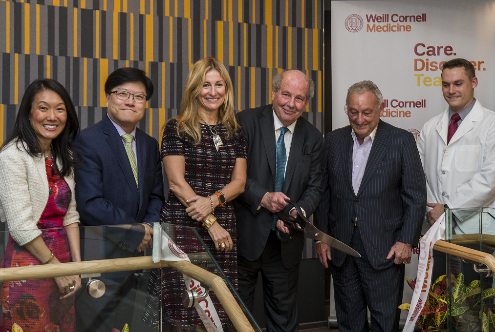 Weill Cornell Medicine leaders gather for a ribbon cutting to officially open the Feil Family Student Center