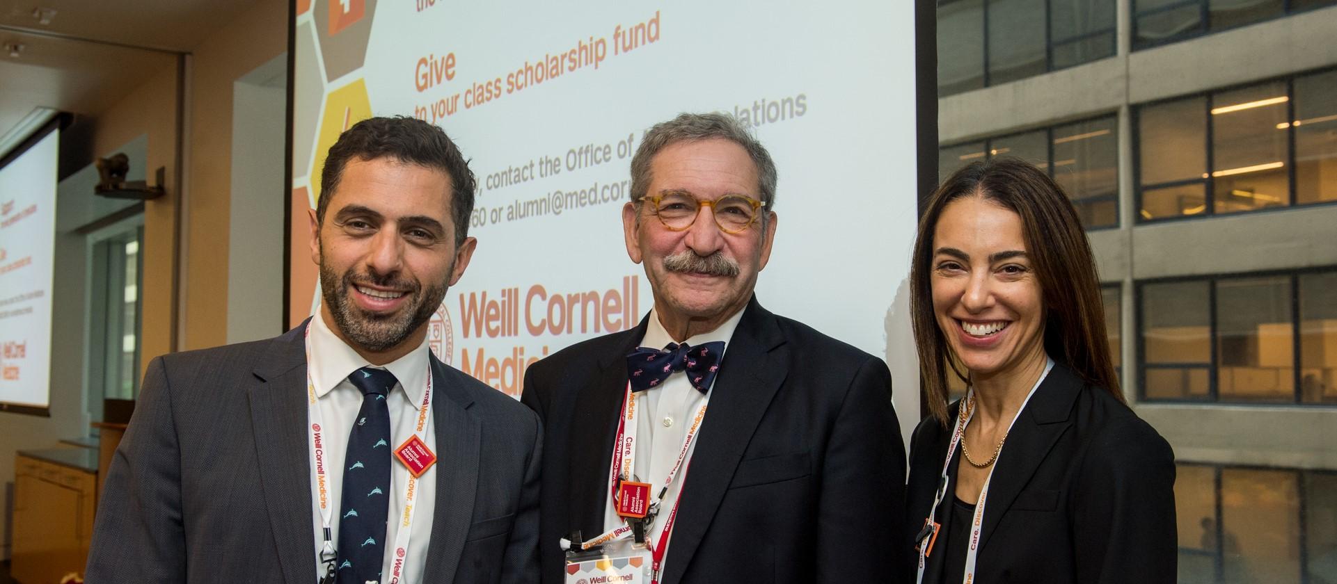 three board members smiling